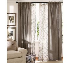 Love the layered drapes-- solid color for top layer and geometric patterned sheer underneath hanging by hardware