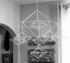This is a decahedron himmeli mobile.    Okay, a decahedron is a polyhedron with ten flat faces. A himmeli is a traditional Finnish Christmas ornament, usually made of straw, created to encourage a good harvest.