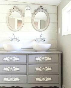 Contemporary Bathroom Features A Navy Washstand Topped