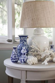 blue with coral - white ginger jar lamp with burlap shade. Perfect summer look