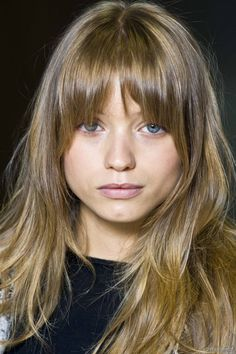 Long rounded bangs   Rounded bangs that are shorter in the middle than they are at the sides create a slightly rounder appearance while drawing attention to the eyes and cheekbones.