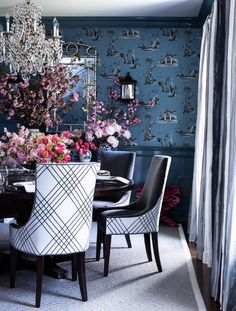 Blue dining room with glossy blue wainscoting displaying a silver bamboo mirror mounted on blue print wallpaper wall. Blue Rooms, White Rooms, Navy Blue Decor, Dining Room Blue, Dining Rooms, Wicker Dining Chairs, Adirondack Chairs For Sale, Chinoiserie Wallpaper, Enchanted Home