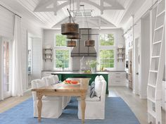 This Cape Cod inspired lake house features interiors designed by Amy Studebaker Design, located in Nantucket Point, Lake Ozark, Missouri.