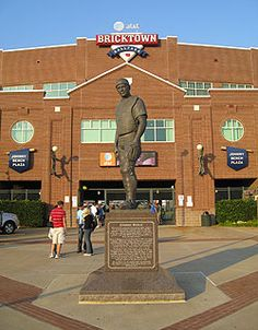 Bricktown ballpark distinctive red brick exterior is seen behind the statue of Johnny Bench, who was born in Oklahoma.  AAA team