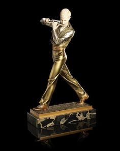 Ferdinand Preiss (German, 1892-1943) 'The Flute Player' a Cold-Painted Bronze and Carved Ivory Model, circa 1925