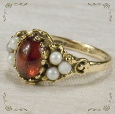 oooh, do i want this one: Wonderful Vintage Garnet Cabochon Pea Pearl 14k Gold Ring ($ 289)