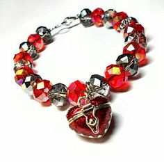 SALE Victorian Iridescent Red & Silver Gem Cut Oval Glass Beaded Bracelet w/Dangling Red Open Clasp Pill Heart Locket Charm FREE SHIPPING - Only $6.95 on Etsy! https://www.etsy.com/listing/237182264/sale-victorian-iridescent-red-silver-gem