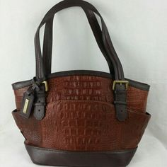 CYBER MONDAY SALENWOT Tignanello Croc Leather Classy handbag by Tignanello with croc leather!  It will go back to $90 tomorrow. :)  Body 100% genuine leather Trim all man made material  Lining 100% ployester.  Approximately:  Base: 9L× 6H Body 14.5 in L×9 in H Handle:9 in H.  This handbag is $85 on my website! Check out my online store for more items and free shipping! daisys-fashion.com    Instagram @daisys_fashion  Thanks! Tignanello Bags Shoulder Bags