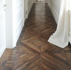 white paneled walls and old wooden flooring. corridoio con bianca e parquet originale Schöner holzflur Elegant paneling. Flooring, House Design, New Homes, Luxury Property, House, Home, Interior, Home Decor, Floor Design