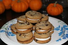 lots of yummy foods - This is a simple recipe: 1 box Entenmann's chocolate chip cookies and a can of vanilla frosting. Put the icing in a baggie and pipe it onto one cookie, top with another. Super simple!