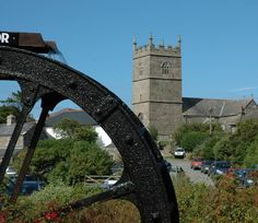 Cornwall - water wheel and church and Zennor, a small hamlet on the coast road between St. Ives and Lands End