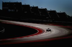Jenson Button of Great Britain and McLaren drives during practice