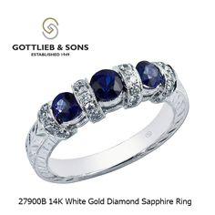 Do you love beautiful #blue sapphires? This 14K White Gold Diamond Sapphire ring features three matched round blue #sapphires alternating with diamond dividers and a hand engraved band. Visit your local #GottliebandSons retailer and ask for style number 27900B. http://www.gottlieb-sons.com/fine-jewelry/rings-for-her/colored-gem/27900B