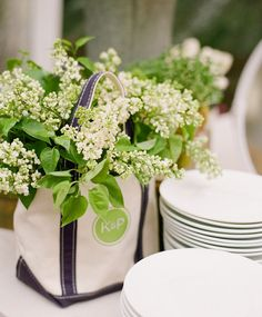 decorate your wedding with flowers in tote bags... easy to give away to the guests at the end of the night!
