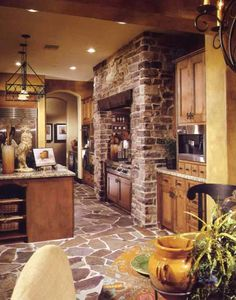 Stonework around range. such a cozy but spacious kitchen... could do without the rooster thou lol.
