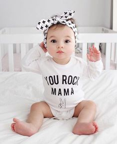I am actually at a loss of words to explain how gorgeous this little lady is! I mean those eye, lips, nose & cheeks! @breannapw you make gorgeous babies! Shop her cross head wrap in our shop now! Link in bio. #xolittle #babyaccessories #babybows