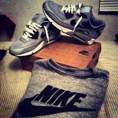 grey nike sweatshirt and shoes