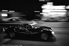 Need for speed: McQueen, a well-known car junkie, depicted behind the wheel of his Jaguar XK-SS on Sunset Boulevard