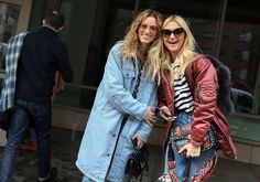 Natalie Scicolone and Zanna Roberts Rassi in a Burberry jacket and Levis jeans with a Valentino bag
