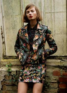 Botanical print evolution as leather motorcycle jacket is paired back to matching skirt.