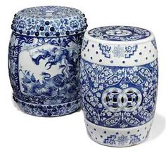 TWO CHINESE BLUE AND WHITE PORCELAIN PIERCED BARREL-SHAPED GARDEN SEATS.