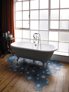 Starry cement tile, paired with a lovely old wood floor. It's the best of both worlds.