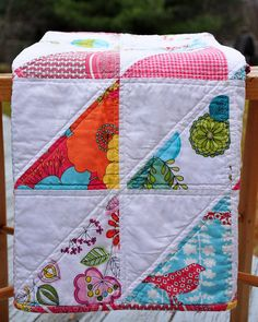 modern girls quilt - I like the machine quilting. Looks good - outline stitch.