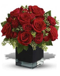 Lush, lavish and spectacularly chic, this gorgeous contemporary bouquet of red roses in a stunning black cube vase makes an exciting gift for almost anyone. Wouldn't you love for someone to send it to you? Christmas Flower Arrangements, Rose Arrangements, Artificial Flower Arrangements, Christmas Flowers, Ikebana, Silk Flowers, Beautiful Flowers, Pretty Roses, Flowers Garden