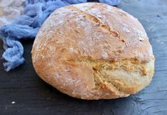 The easiest, fastest, no knead rustic crusty bread recipe ever, baked on a hot pizza stone until the crust crackles like a beautiful melody.