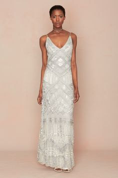 Glam up your destination wedding with the Brusse Dress from the @calypsostbarth Mariee Bridal Collection available at select boutiques and online. #MarieeBridal #CalypsoStyle