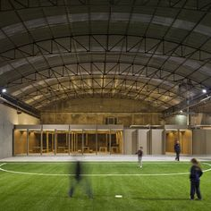 An industrial warehouse in Coimbra converted into a football ground by Comoco Architects.