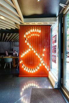Estate agent Johns&Co showcases the Baby Plumen like no one else! This display in Canary Wharf has a Hollywood feel to it!