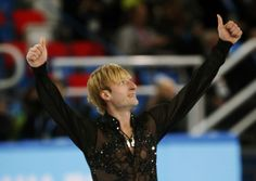 Evgeny Plyushchenko of Russia celebrates at the end of his program during the Team Men Free Skating Program at the Sochi 2014 Winter Olympic...