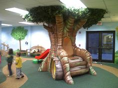 Worlds of Wow - sculpted foam play elements like this tree include both a tunnel and a slide safe and fun for Pre-K children. A great place for this would be in front of the furnace room door. Playground Slide, Outdoor Playground, Playset Diy, Soft Play Centre, Worlds Of Wow, Toddler Rooms, Toddler Play, Kids Attractions, Library Inspiration