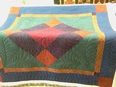 Pieced with Cherrywood fabrics quilted with Glide.