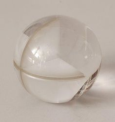 Solid clear glass Serica ball 1000-35 with crossed saw notch design Floris Meydam 1973 executed by Glasfabriek Leerdam / the Netherlands