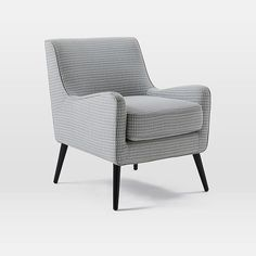 NEW! The soft, subtle curves of our Book Nook Armchair make it an inviting spot to relax. The slim-lined profile makes it great for small spaces and cozy corners.