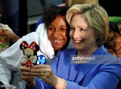Democratic presidential candidate Hillary Clinton takes a selfie with campaign supporters during a campaign stop at the Union of Carpenters and Millwrights Training Center May 15, 2016 in Louisville,...