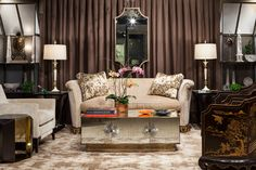 Landy Gardner Interiors living space from ADAC: Behind the Windows. #browns #neutrals #seating #sofa #curtain #mirror #metal @donghia / Spring 2014