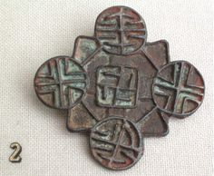 Swastika device from Mongolia found in northwest China.  Dated circa 13th-14th century. Note the crosses also indicating Christian influence--almost certainly Nestorian in character.