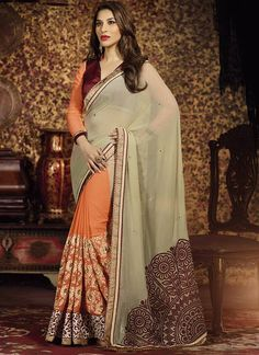 Add the sense of feminine beauty by this Sophie Chaudhary grey and orange raw silk and georgette half n half designer saree. This attire is nicely designed with embroidered, patch border and resham wo...