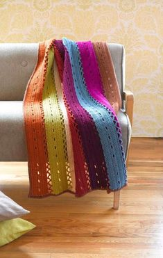 If you're looking for something to really brighten up your room then this is the perfect crochet pattern for you. Make a windchime afghan pattern. Stripes and lace combine to make this afghan perfect. Crochet Hat For Women, All Free Crochet, Easy Crochet, Afghan Crochet Patterns, Crochet Afghans, Crochet Blankets, Baby Blankets, Crochet Stitches, Crochet Lion