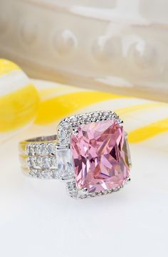 Pop! This bubblegum pink ring is bubble yum in our eyes! We need this popping pink to brighten up our jewelry box.   17.76ctw Pink & White Diamond Simulant Rhodium Plated Sterling Silver Ring