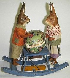 ANTIQUE WIND-UP ROCKING BUNNIES WITH CANDY CONTAINER EGG.
