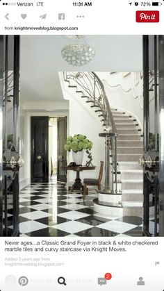 beautiful traditional entry with winding stairs and black and white checkered floor