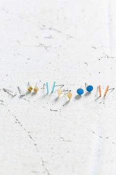 Anthropologie's teeny tiny stud earrings - adorn your ears in affordable style.