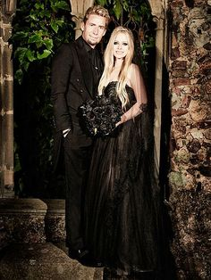 Avril Lavigne, 29, rocked a black tulle Monique Lhuillier gown and carried a bouquet of black roses when she wed Nickelback's Chad Kroeger in a 14th-century French château on July 1