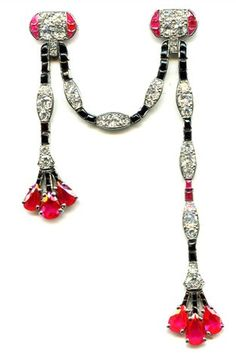 Platinum, ruby, diamond and onyx swag jabot, Cartier, c. 1925.
