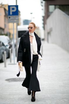 Wide-leg pants paired with an oversized coat.