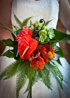 "Incredible ""Tropical"" Bride's Bouquet Arranged With: Red Anthurium, Red Amaryllis, Dark Brown Fern Shoots, Yellow Craspedia, Green China Berry, Gorgeous Green Aspidistra Leaves, Bear Grass, Sword Fern, & Other Mixed Green Foliage....."